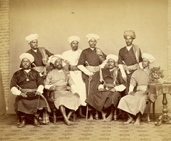 Studio portrait of a group of Coorg priests.